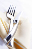 Close up of fork and knife lies on cloth Stock Images