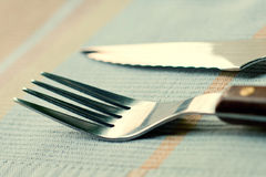 Close-up Fork and knife on a napkin. soft focus effect Stock Photos