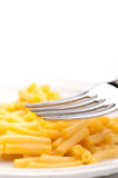 Close up of a fork and macaroni and cheese Royalty Free Stock Photography