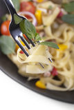 Close up fork with pasta sauce and tagliatelle Royalty Free Stock Photos