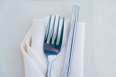 Close up fork on white napkin in restaurant Stock Photos