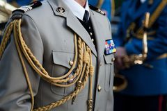 Close up on the formal uniform of the French Army, Ground Forces Armee de Terre, DGRIS Division during a ceremony Stock Photo