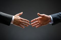 Close up of forthcoming handshake Stock Image