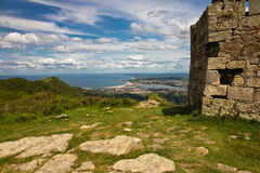 Close up fortress with biscay bay in the back on atlantic coast in blue sky with clouds. Panoramic overhanging view on wonderful biscay bay in blue sky with part Royalty Free Stock Photos