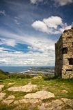 Close up fortress with biscay bay in the back on atlantic coast in blue sky with clouds. Panoramic overhanging view on wonderful biscay bay in blue sky with part Stock Photo