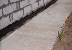 Close up on foundation waterproofing, vapor barrier. Building new house. Royalty Free Stock Images