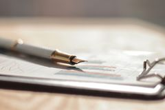 Close up.fountain pen on the table at the businessman.photo with copy space royalty free stock image