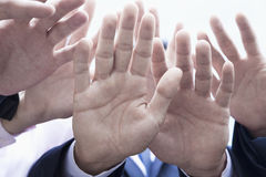 Close-up of four business people's hands Royalty Free Stock Image