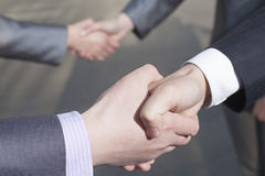 Close up of four business people shaking hands Royalty Free Stock Photos