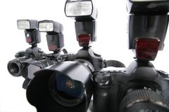 Close-up four cameras with flashes Stock Images