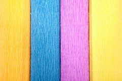 Close-up of four colored crepe paper rolls, texture for backdrop stock images