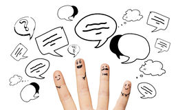 Close up of four fingers with clouds. Communication, family, people and body parts concept - close up of four fingers with different facial expressions and text Royalty Free Stock Image