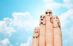 Close up of four fingers family with smiley faces Stock Photo