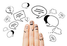 Close up of four fingers with message clods. Communication, family, people and body parts concept - close up of four fingers with different facial expressions Stock Images