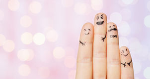 Close up of four fingers with smiley faces Royalty Free Stock Photos