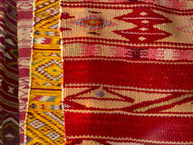 Close up of four hanged colourful handmade traditional wool rugs Stock Image