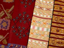 Close up of four hanged colourful handmade traditional wool rugs royalty free stock photography