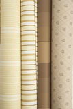 Close up of four wall paper rolls. Close up of four rolls of wall paper rolled up in row Royalty Free Stock Image