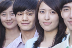 Close Up of Four Young People Standing in a Row in Beijing Royalty Free Stock Photo