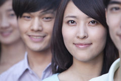 Close Up of Four Young People Standing in a Row in Beijing Royalty Free Stock Photos