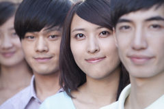Close Up of Four Young People Standing in a Row in Beijing Stock Photo
