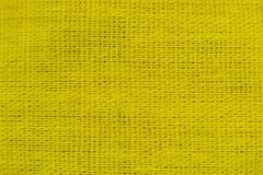 Close-up frabic liso amarelo Imagens de Stock