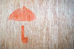 Close up of fragile symbol. On wood board royalty free stock photography