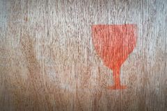 Close up of fragile symbol. On wood board stock image