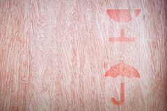 Close up of fragile symbol. On wood board stock photography