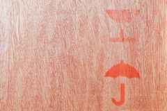 Close up of fragile symbol. On wood board stock photos