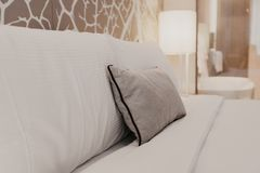Close up fragment of bedroom with reading lamp in modern home or hotel stock photography