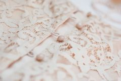 Close Up Fragment Detail of Lace Women dress with Buttons Fashion Texture Background royalty free stock images