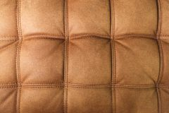 A close-up of a fragment of an expensive brown textile sofa in the room stock photos