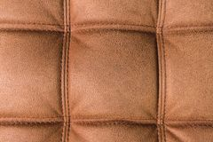 A close-up of a fragment of an expensive brown textile sofa in the room royalty free stock images