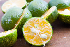 Close Up freash of calamansi cut on wood Royalty Free Stock Photography