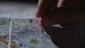 Close up of French city map, hand of tourist marking trip destination with pin. Stock footage stock footage