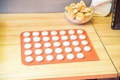 Close up pink macroons on baking dish stock image