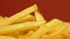Close up of french fries, unhealthy fatty food with big amount of calories