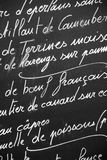 Close up of a French restaurant menu written with chalks on blackboard, Paris France. French cuisine, France travel and tourism concept Royalty Free Stock Photography
