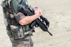 Close up of a French soldier with an automatic riffle, war emergency state concept. Close up of a French soldier with an automatic riffle, war and emergency Stock Photography