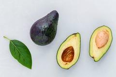 Close up fresh afresh avocado and avocado leaves on marble backg Royalty Free Stock Image