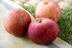 Close up fresh apple on mat Stock Photos