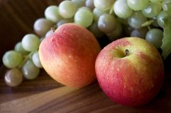 Close up fresh apples and grapes Stock Image