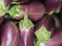 Close up fresh aubergines at market stall Stock Photos