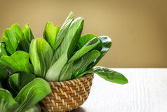 Close up the Fresh baby green bok choy in basket Royalty Free Stock Photos