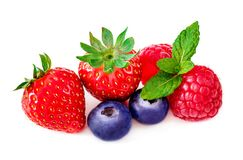 Close up of fresh berries mix  on white background. Ripe. Raspberry, blueberries, strawberry and mint leaf. Colorful healthy food concept Stock Image
