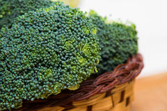 Close up on Fresh broccoli solated in basket on wood and white background Stock Photography