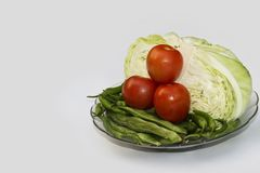 Close up on Fresh cabbage , beans, Green Chilli and Cherry tomato Organic vegetable background in freshness atmosphere stock images