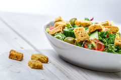 Close-up on a fresh Caesar salad made of vegetables Royalty Free Stock Photos