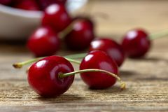 Close up of fresh cherries on wooden table royalty free stock photo